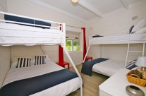 The bunk room is just perfect for the kids to hang out, offering two double beds, and two single beds, sleeping up to six.