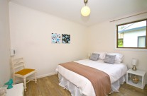 The fourth bedroom also offers a queen bed with pillow top mattress, and is spacious and full of light