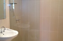 Located off the main bedroom is the ensuite bathroom. The rain water showerhead is a must after a day at the beach.